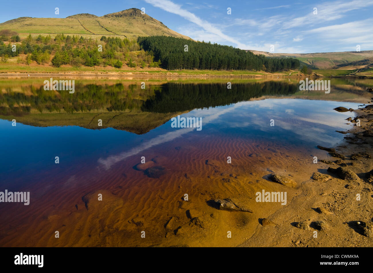 Landscape at Dove stone reservoir in Peak district featuring hill and water reflection - Stock Image