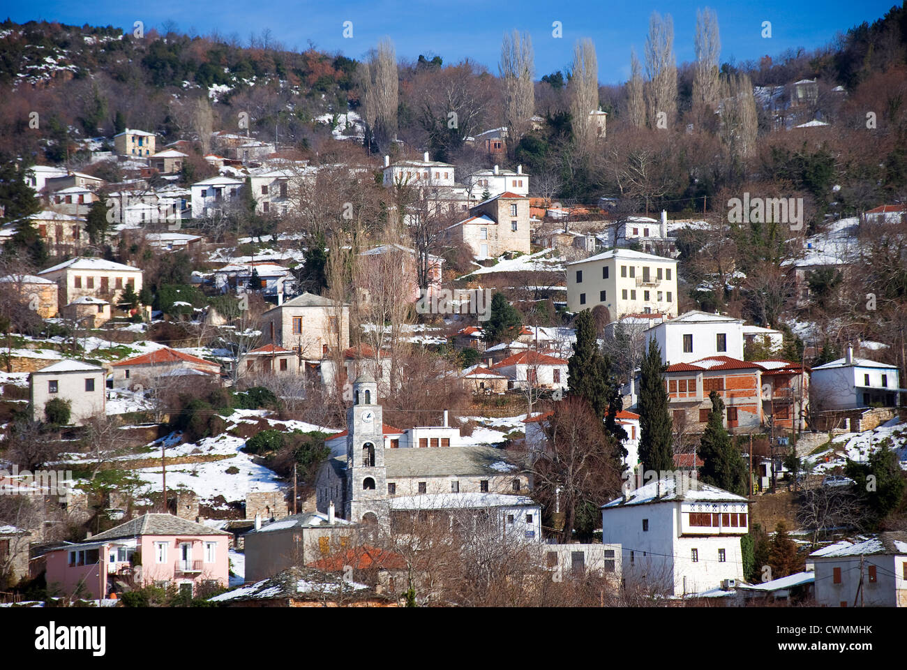 Mountain village Agios Georgios with snowcapped houses in winter (Pelion peninsular, Thessaly, Greece) - Stock Image