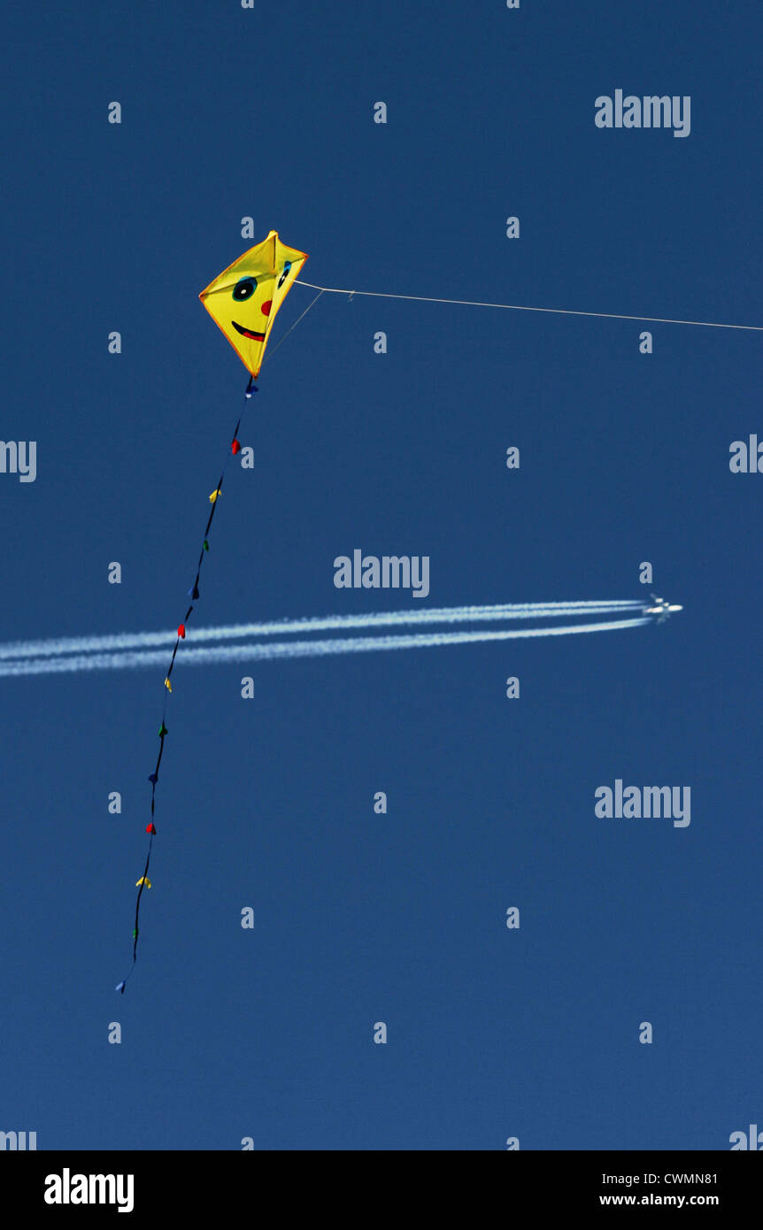 Kite and Jet Plane on Blue Sky - Stock Image