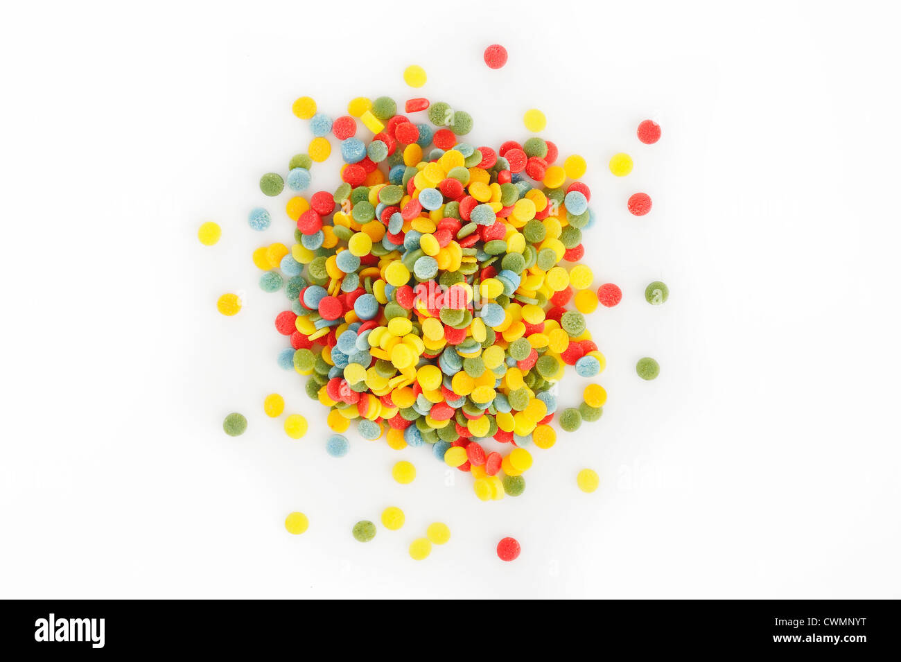 multi-colored sprinkles topping on white background - Stock Image