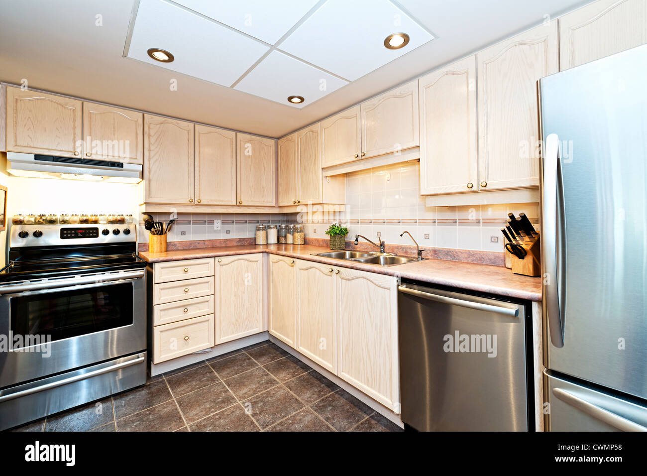 Modern luxury kitchen with stainless steel appliances - Stock Image