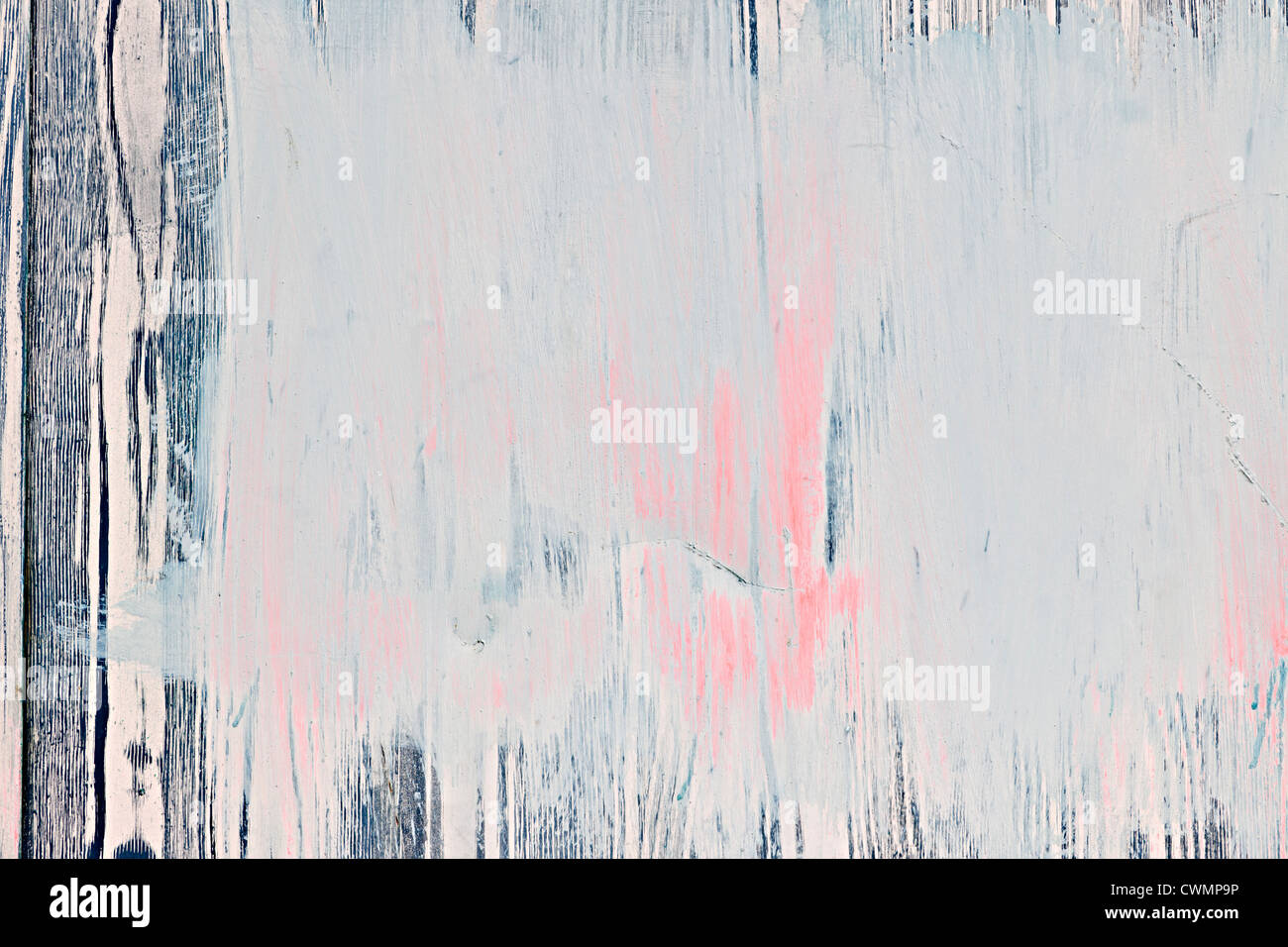 Background of old wood wall with peeling paint - Stock Image