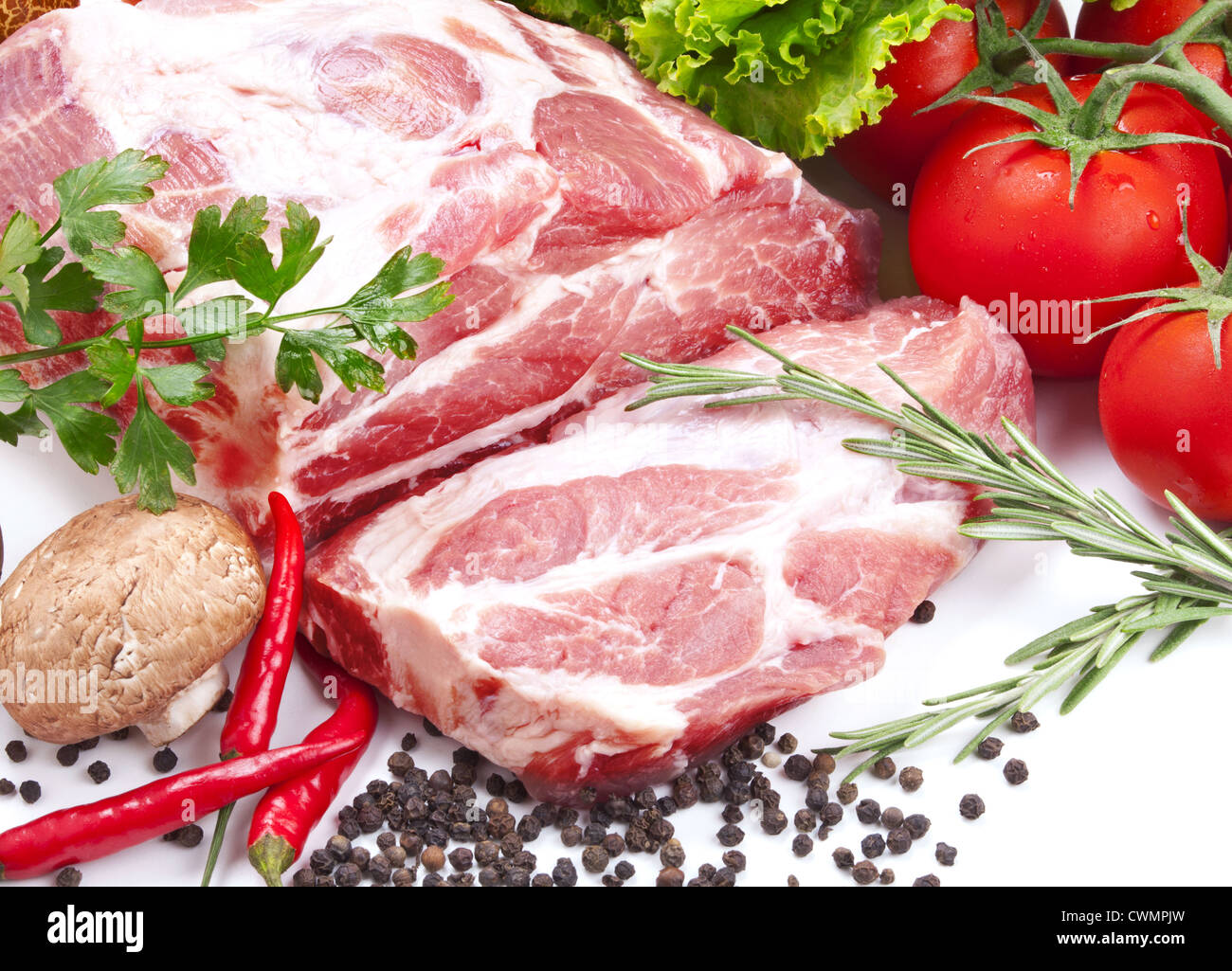 Still life with raw pork meat and fresh vegetables Stock Photo