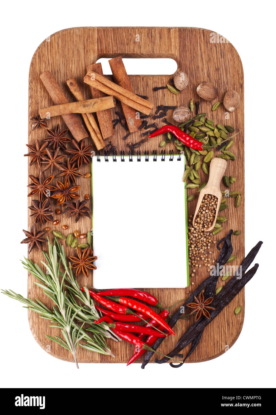 Open notebook with spices and herbs on the old wooden cutting board. Isolated on white. - Stock Image