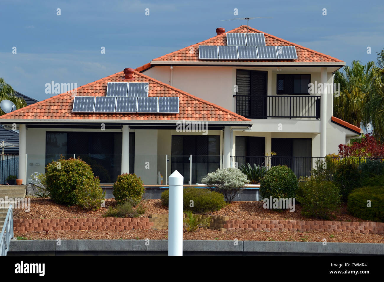 a house on the canal with solar panels - Stock Image