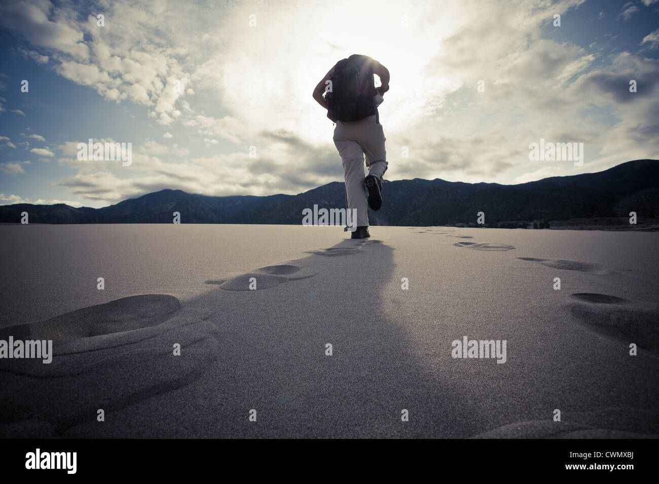USA, Colorado, Great Sand Dunes National Park, Low angle view of tourist walking - Stock Image