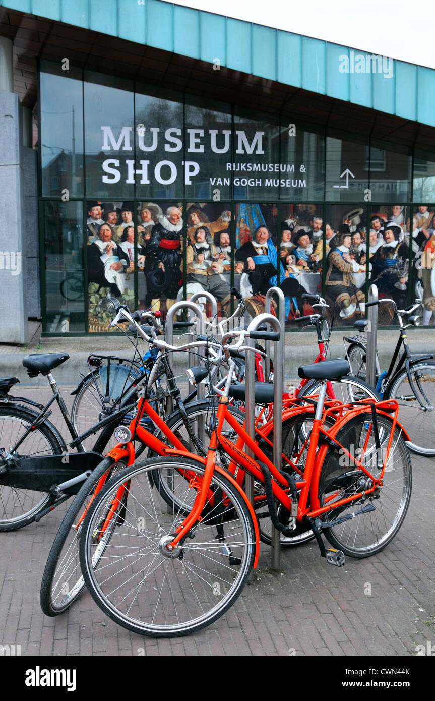 bikes bicycles parked park outside van gogh musuem shop amsterdam - Stock Image