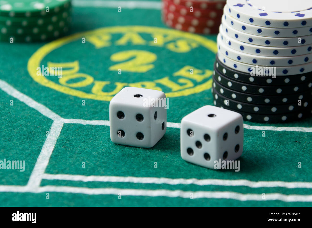 Craps table with casino chips and dice - Stock Image
