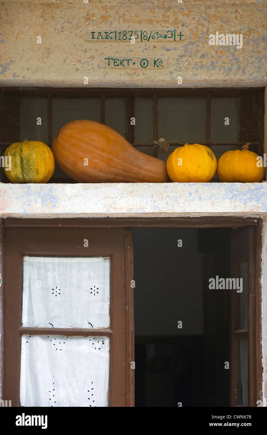 Detail of a front door with decorative pumpkins (Pelion Peninsular, Thessaly, Greece) Stock Photo