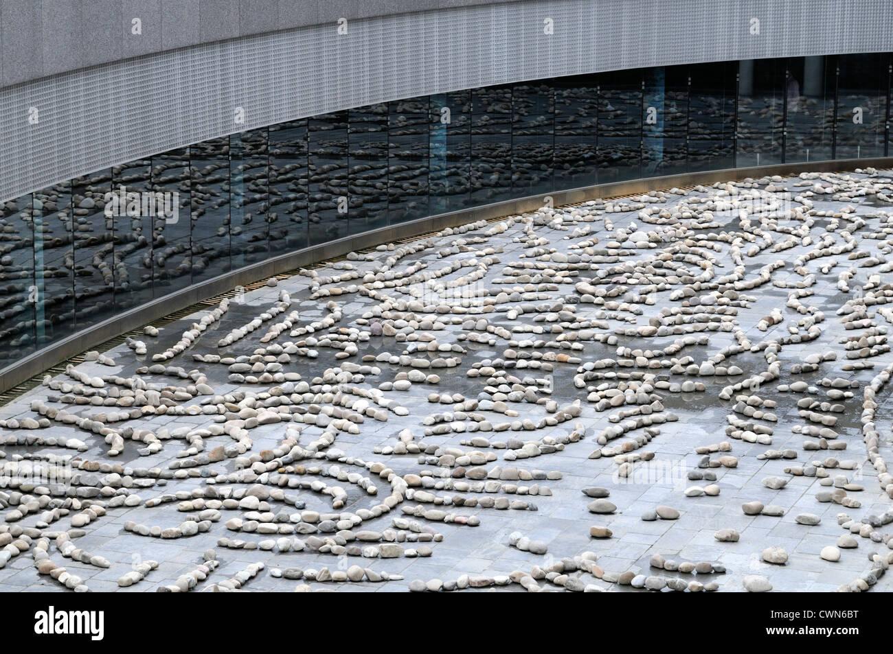 Van Gogh museum stone interpretation of wheatfield with reaper outside - Stock Image