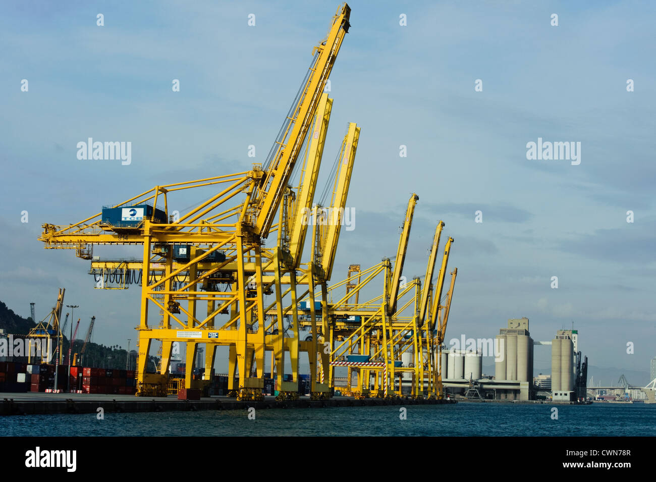 Yellow Rail Mounted Gantry Cranes to handle large cargo in Port Barcelona. - Stock Image