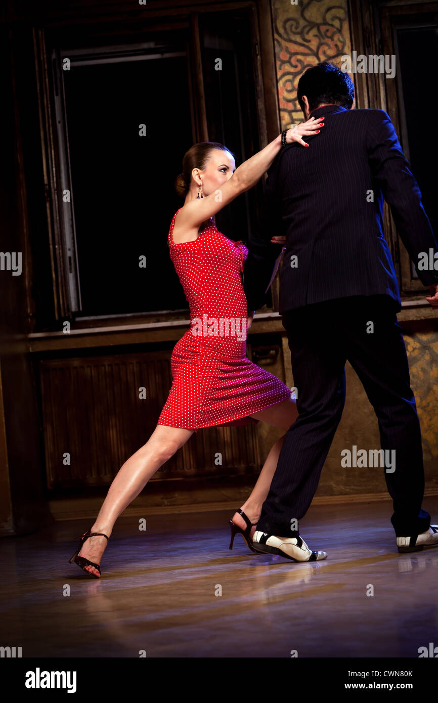 A man and a woman in the most romantic dance: tango. Please see more images from the same shoot. - Stock Image