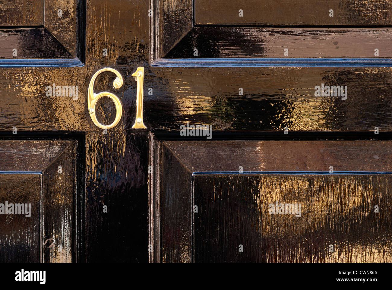 Brass Door Numbers On Black Gloss Painted Wooden Door At Number 61 Frith  Street, Soho, London, England, UK