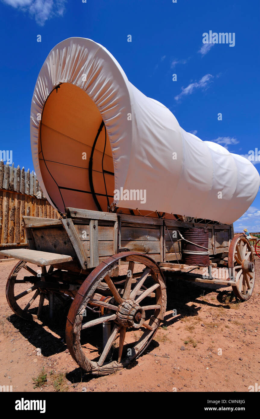 The covered wagon, also known as a prairie schooner, is a cultural icon of the American Old West. This one was in - Stock Image