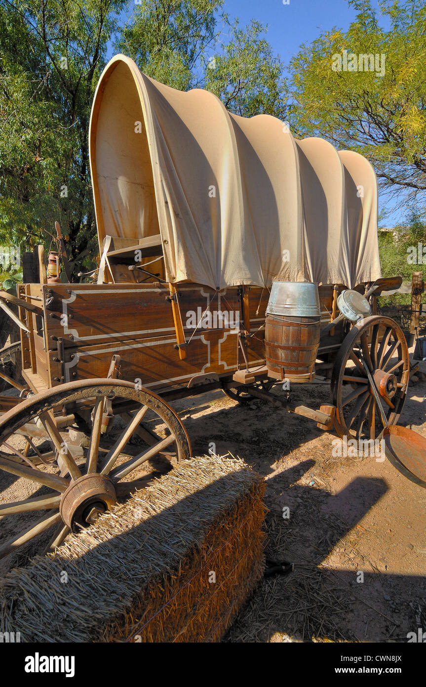 The covered wagon, also known as a prairie schooner, is a cultural icon of the American Old West. - Stock Image