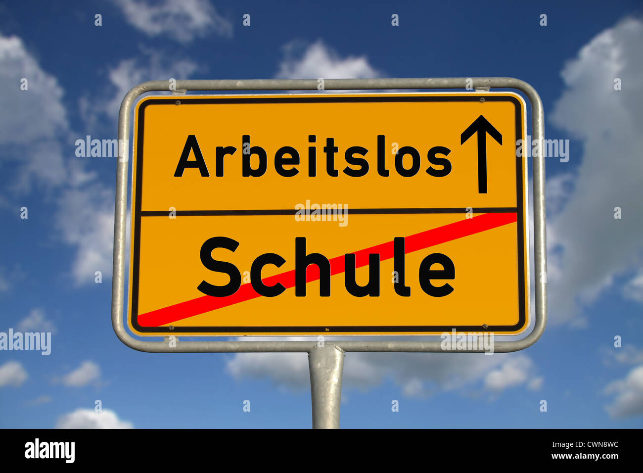 German school sign school and unemployed with blue sky and white clouds - Stock Image