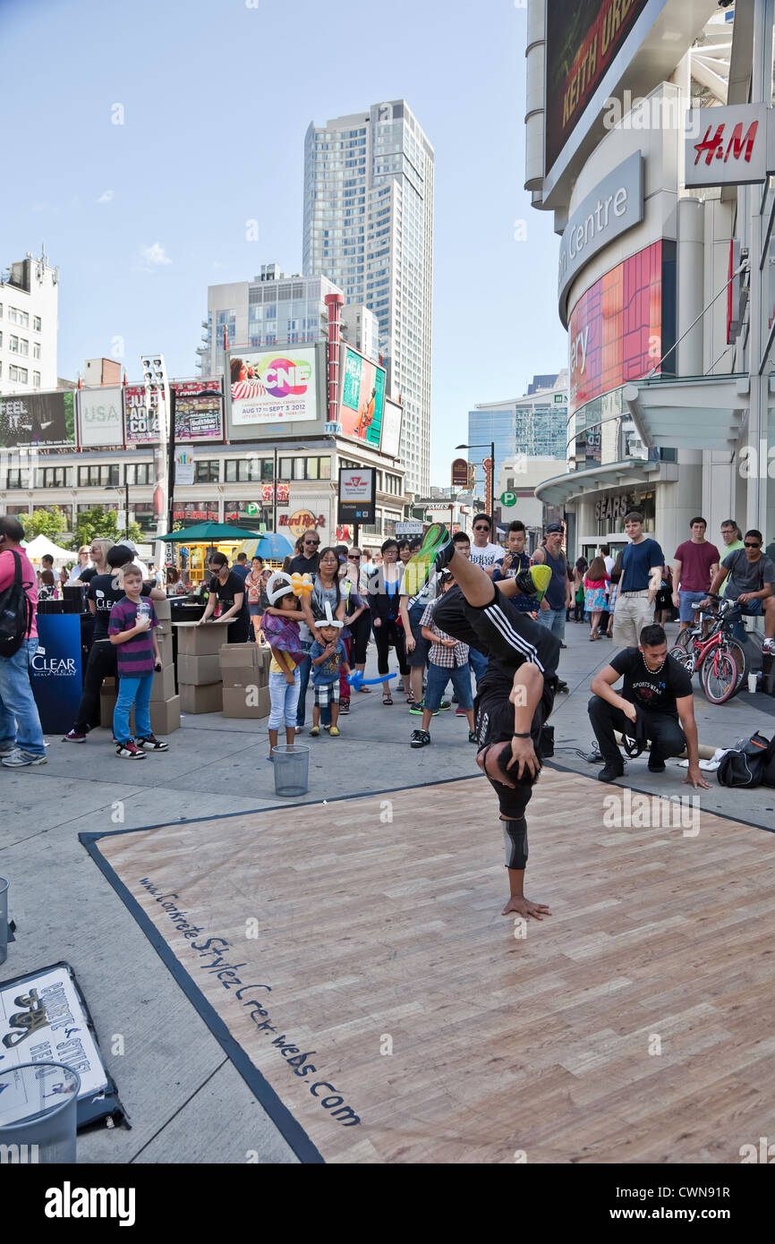 Breakdancing or Brake Dancing by Street Performers in downtown Toronto on Yonge and Dundas in Toronto;Ontario;Canada Stock Photo