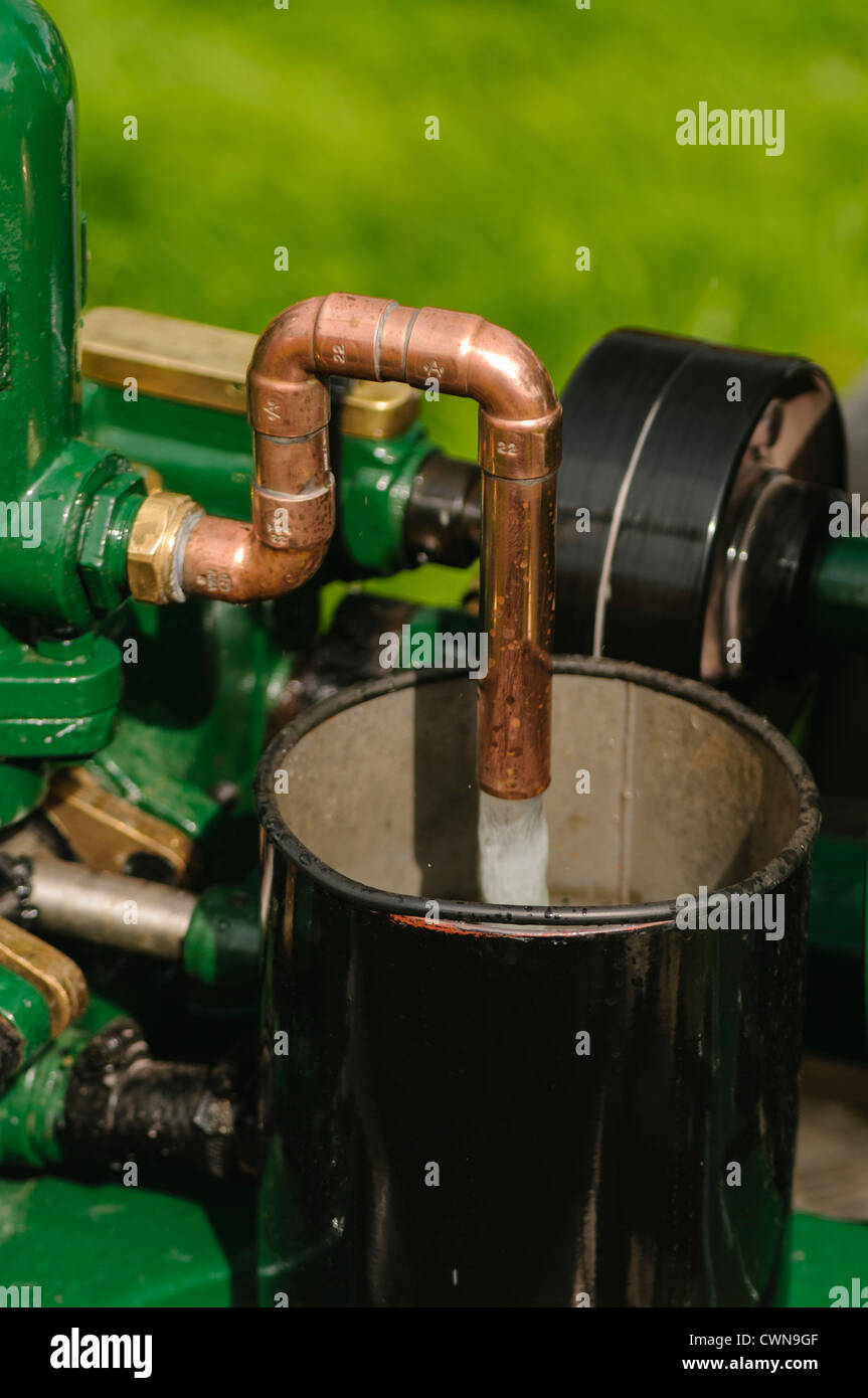 Stationary engine pumping water - Stock Image