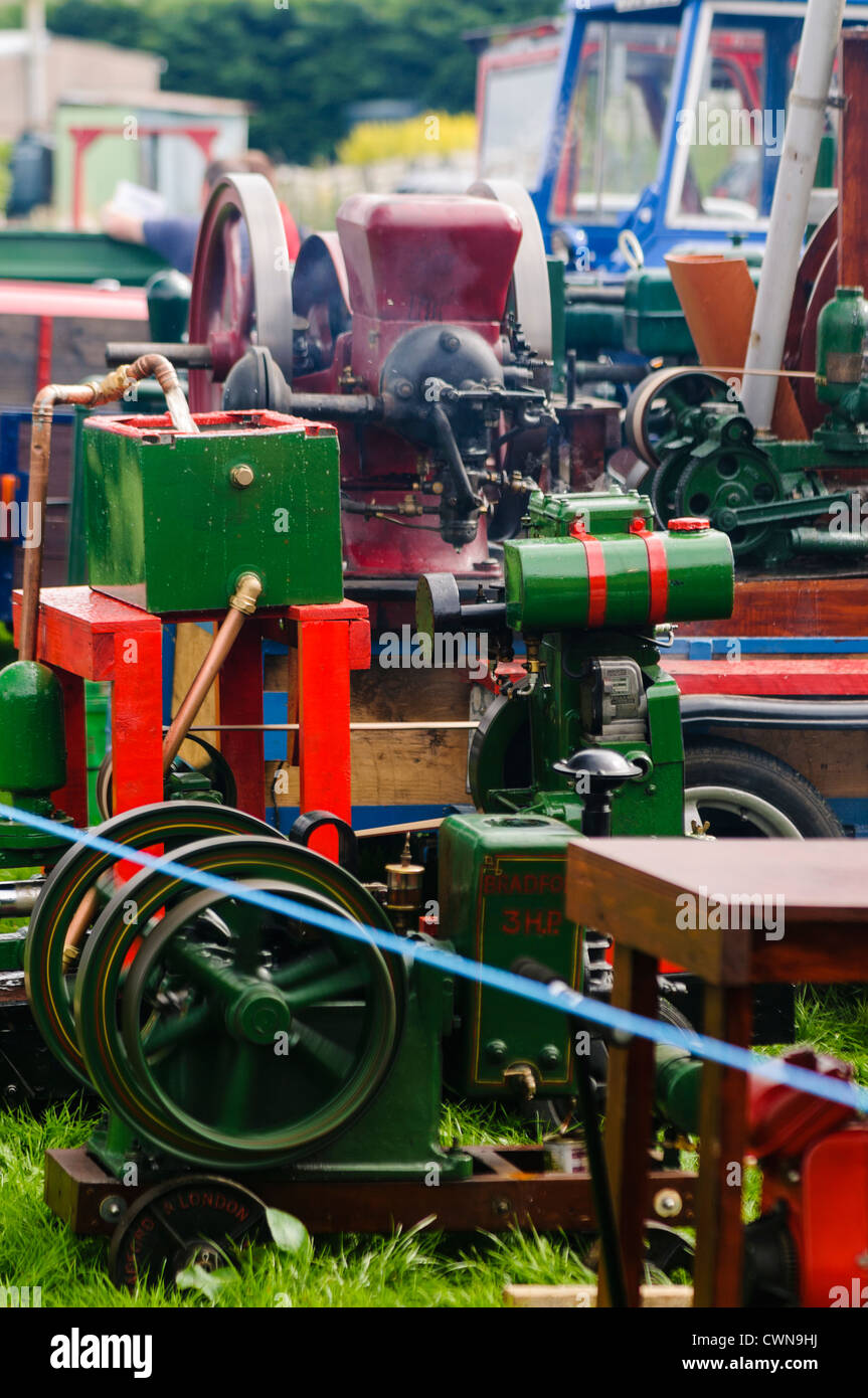 Collection of vintage stationary engines at a fair - Stock Image