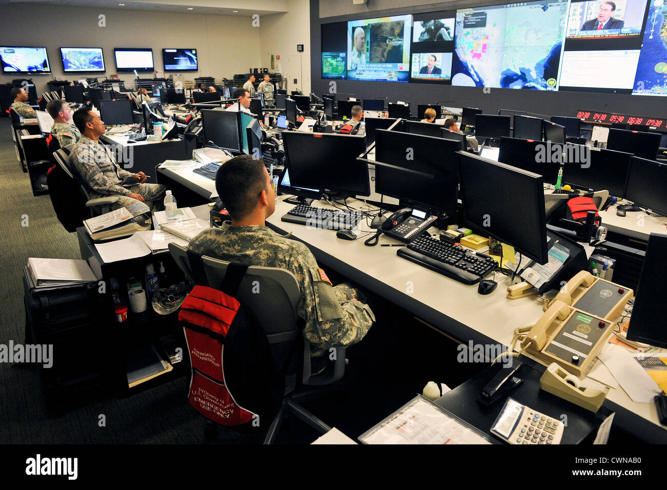 Personnel in the National Guard Command Center in Arlington, Virginia monitor the progress of Tropical Storm Isaac - Stock Image