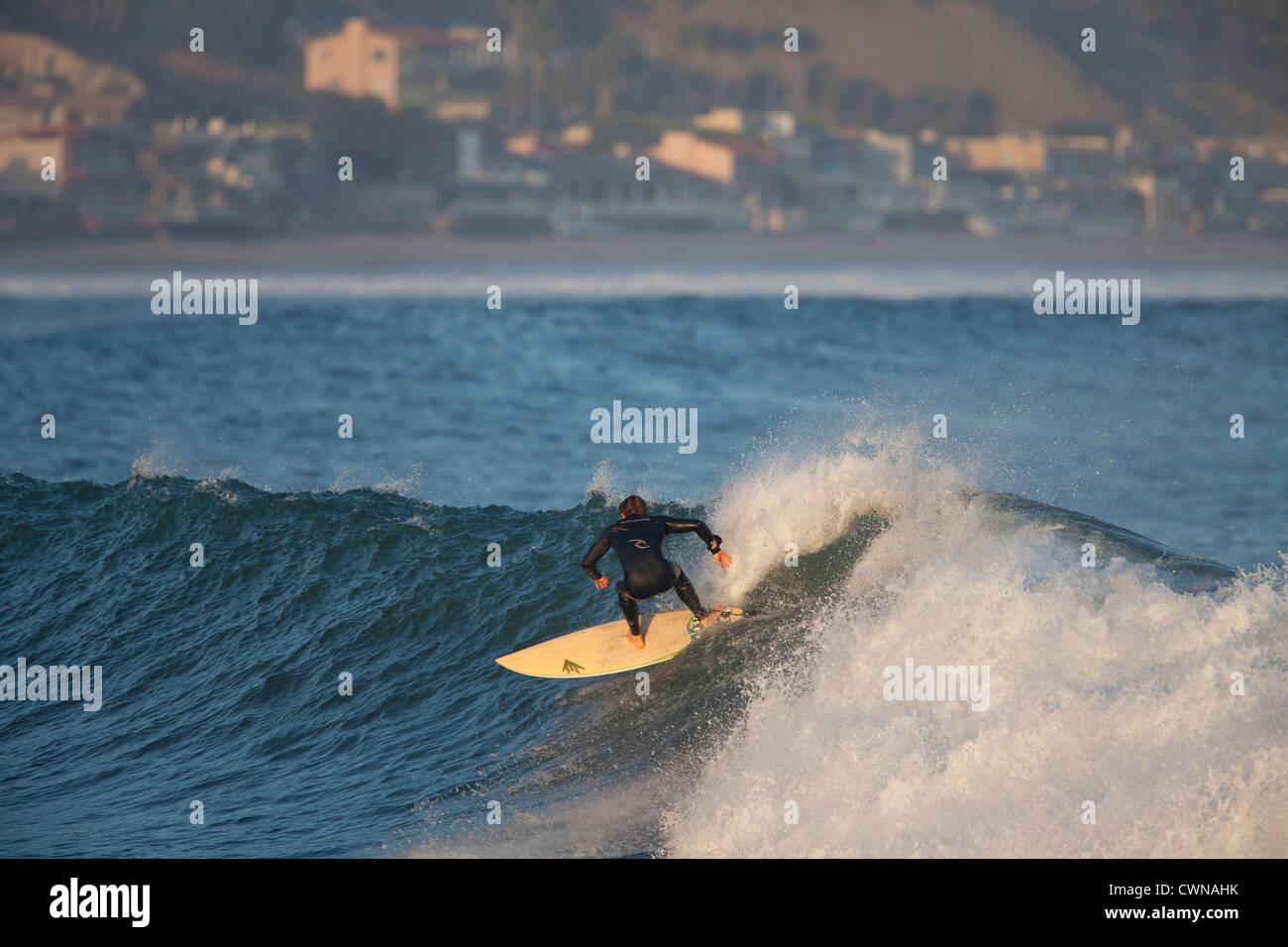 Surfer riding a wave at Malibu beach during a large swell Stock Photo