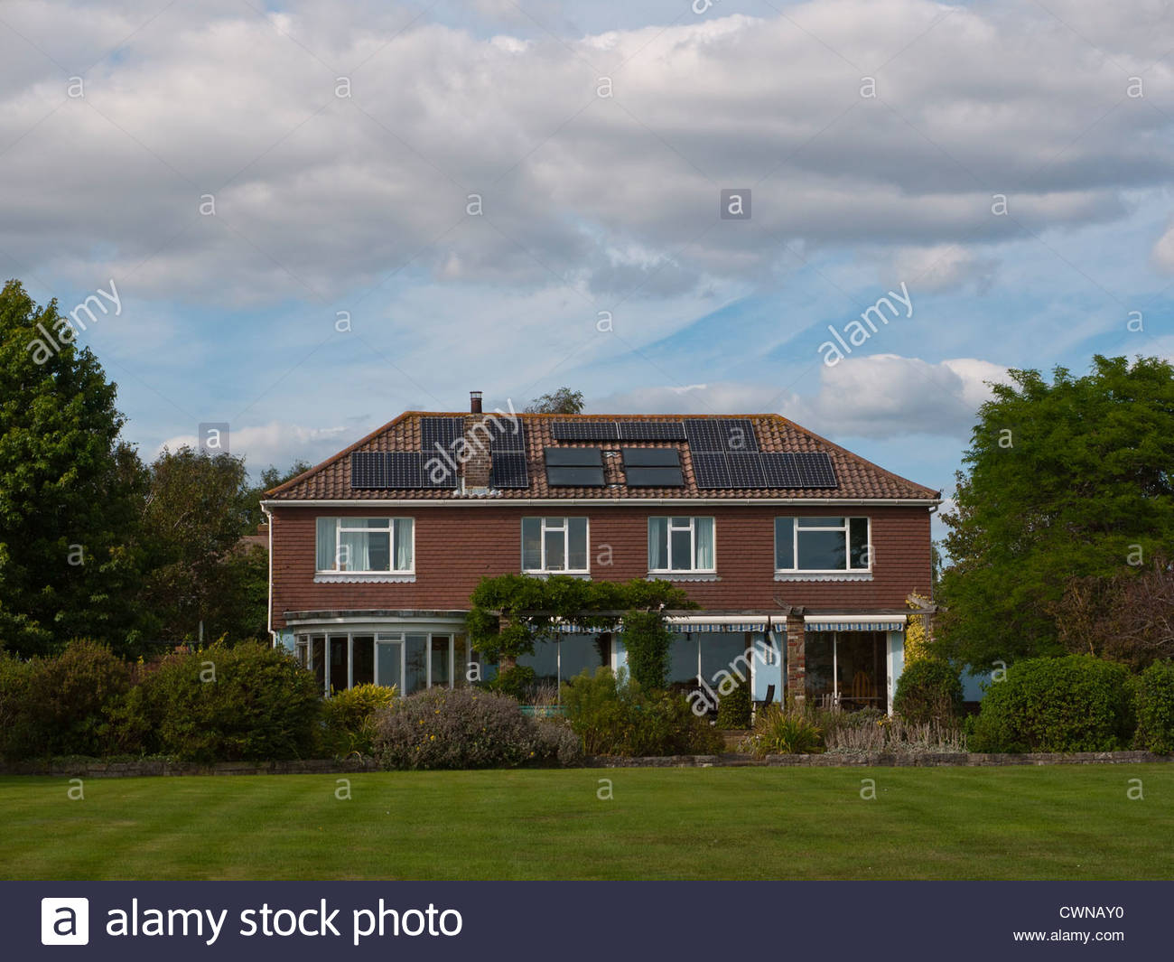 House Covered in Solar Panels - Stock Image