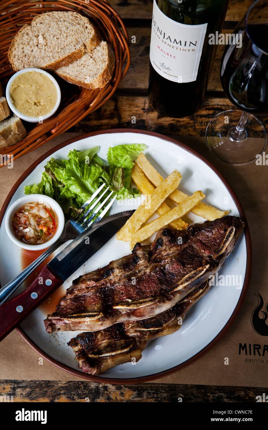 Asado de Tire steak at Miranda restaurant, Palermo Hollywood, Buenos Aires, Argentina. - Stock Image
