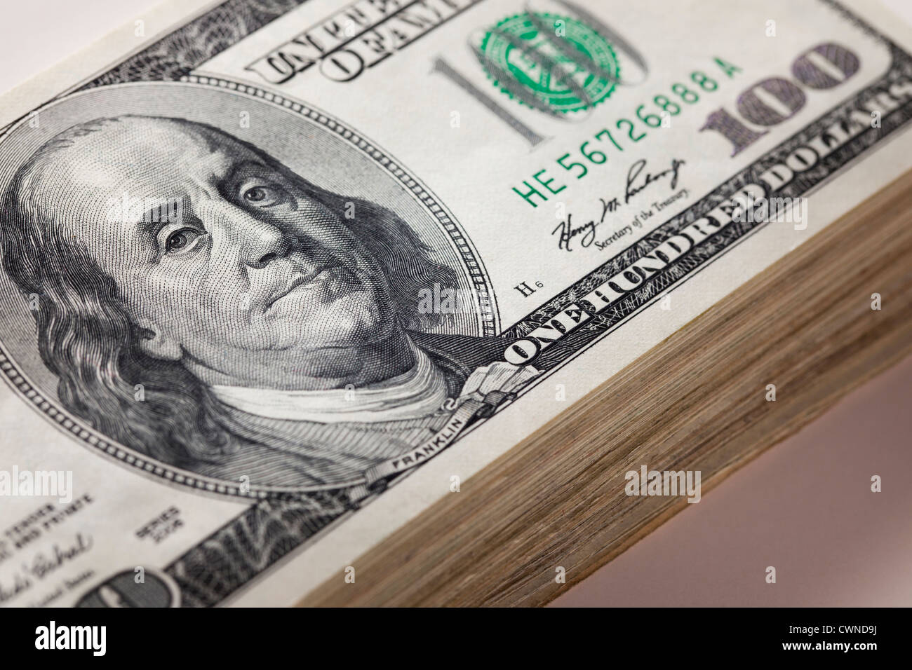 A stack of one hundred dollar bills - Stock Image