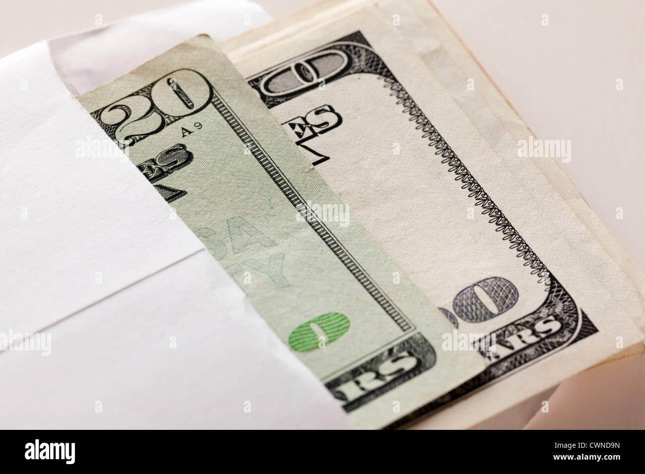 Money in an envelope - Stock Image