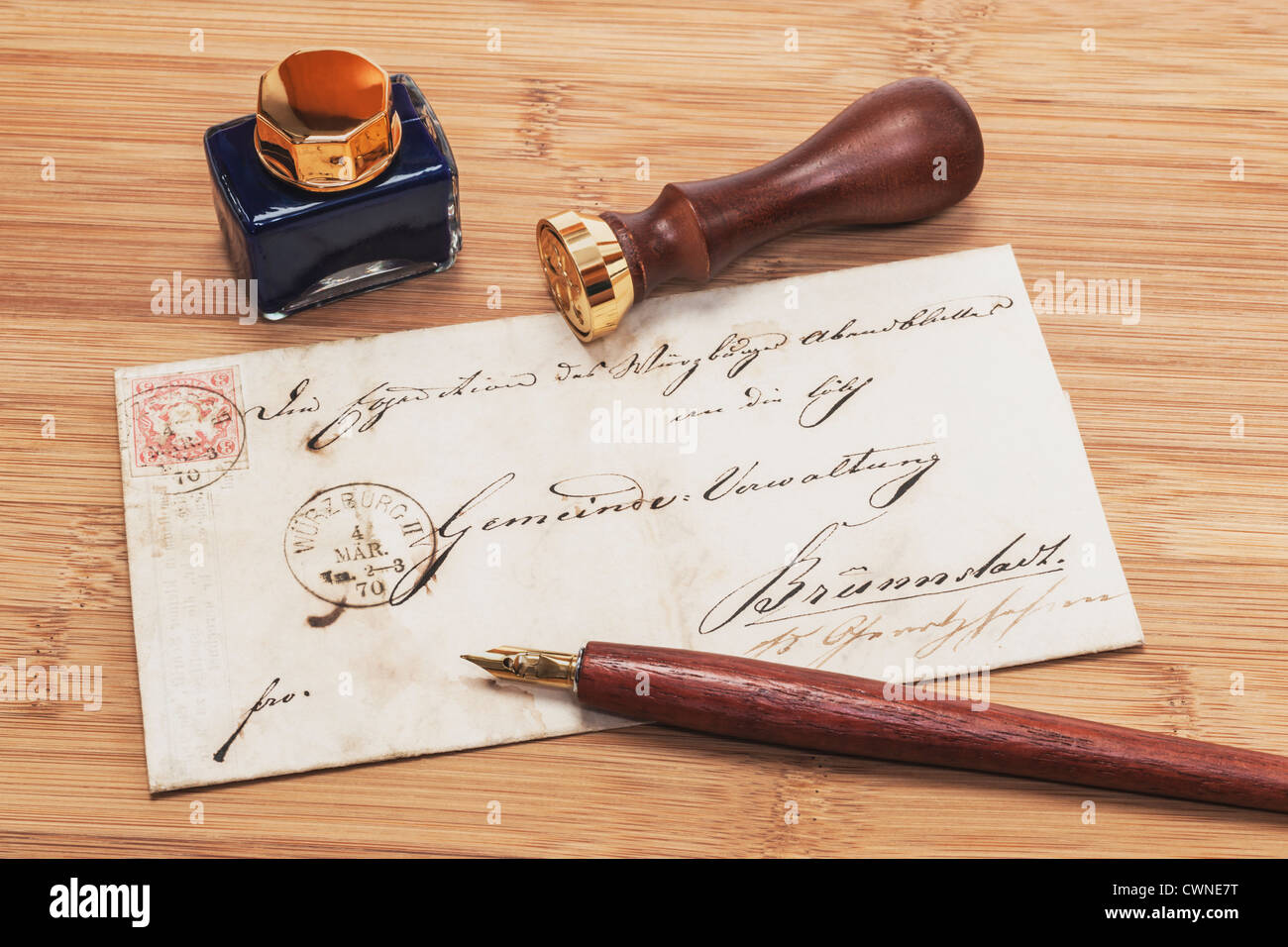 Detail photo of a old German Letter from the year 1870, a pen an ink pot and a Seal are on it - Stock Image