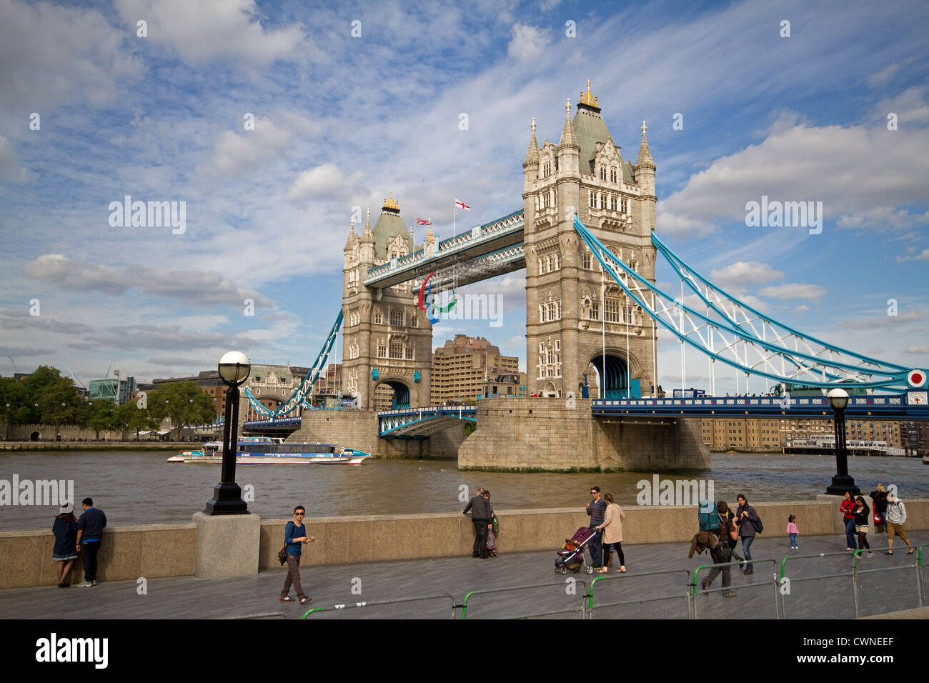 Tower Bridge in London which crosses the River Thames it has the Paralympic symbol on the top during the games 2012 - Stock Image