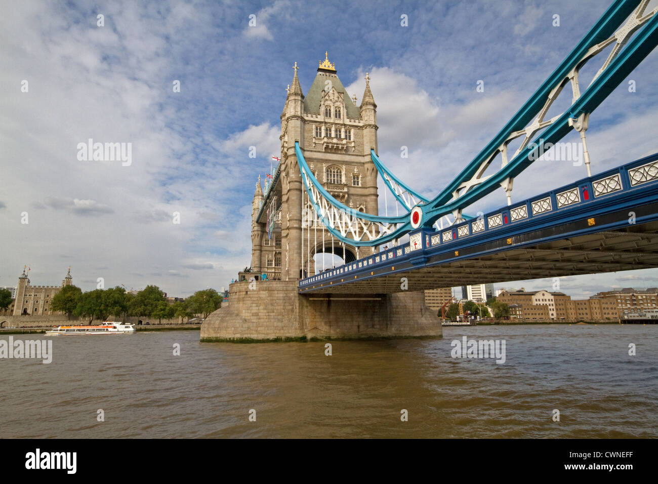 Tower Bridge in London which crosses the River Thames and opens to allow larger ships pass under it. - Stock Image
