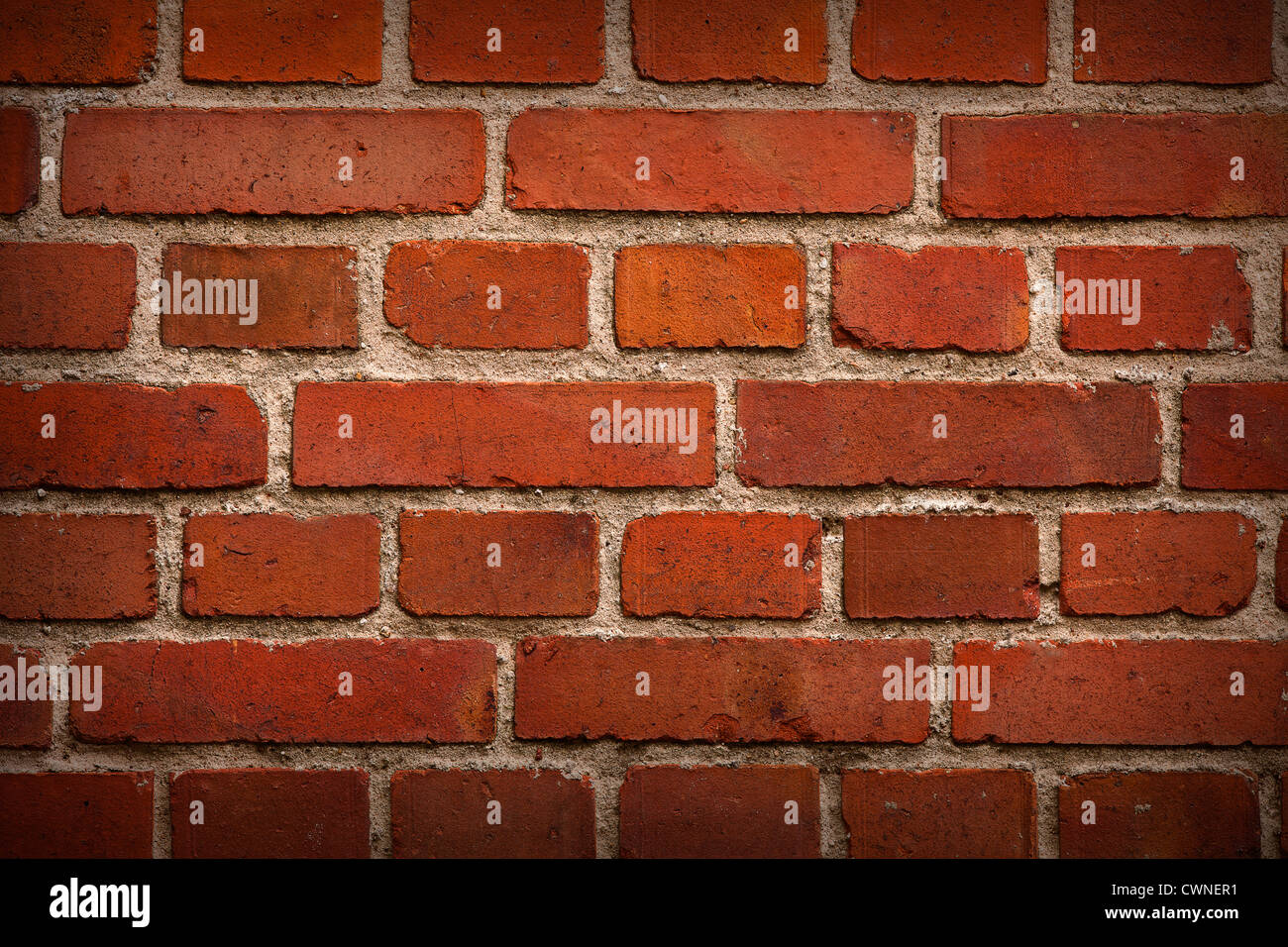 old red brick wall background with shadows in corners Stock Photo