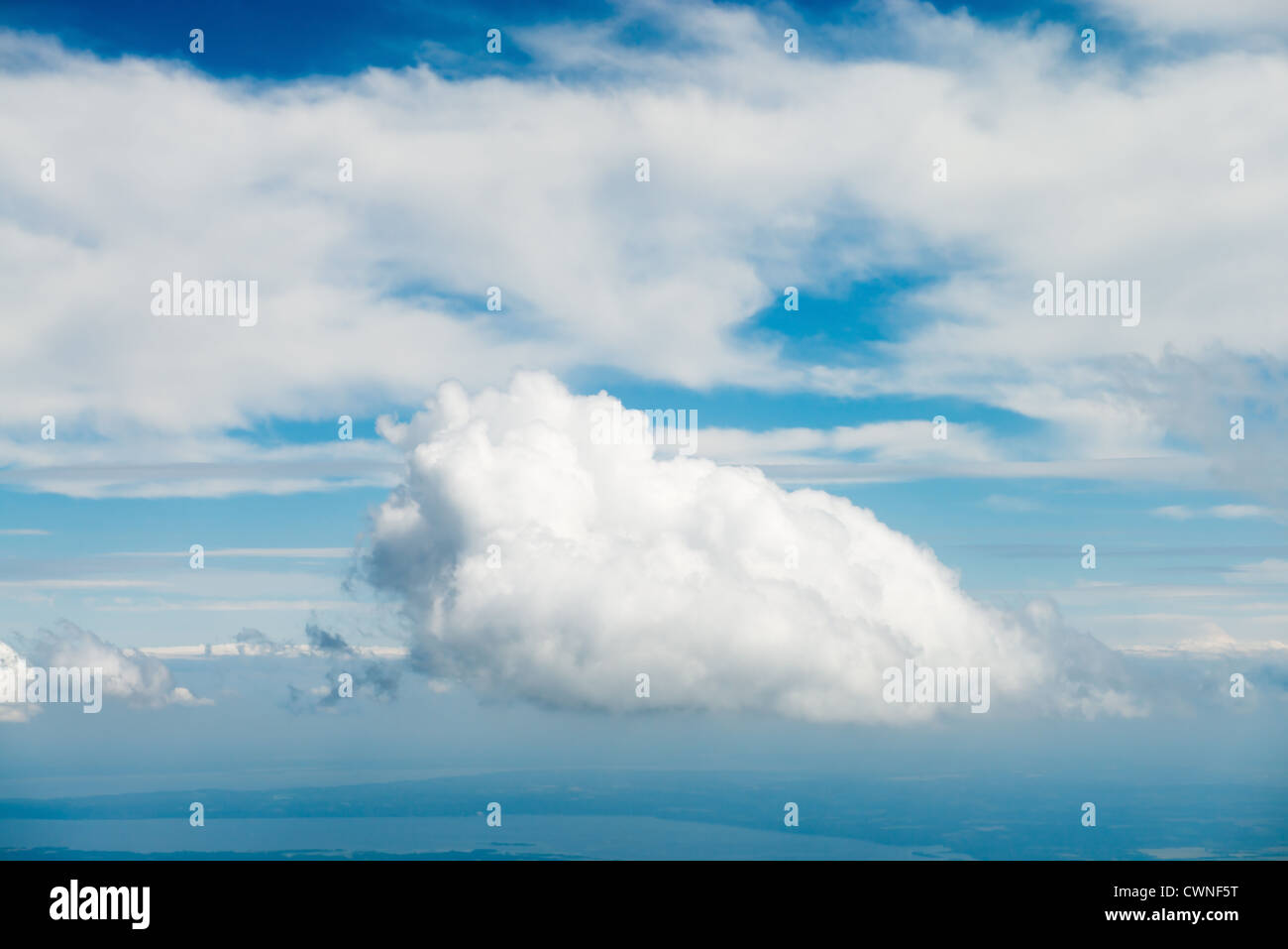 Blue sky with clouds under faraway earth - Stock Image