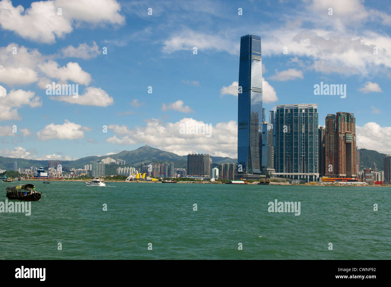 View of the harbour from Tsim Sha Tsui in Hong Kong - Stock Image