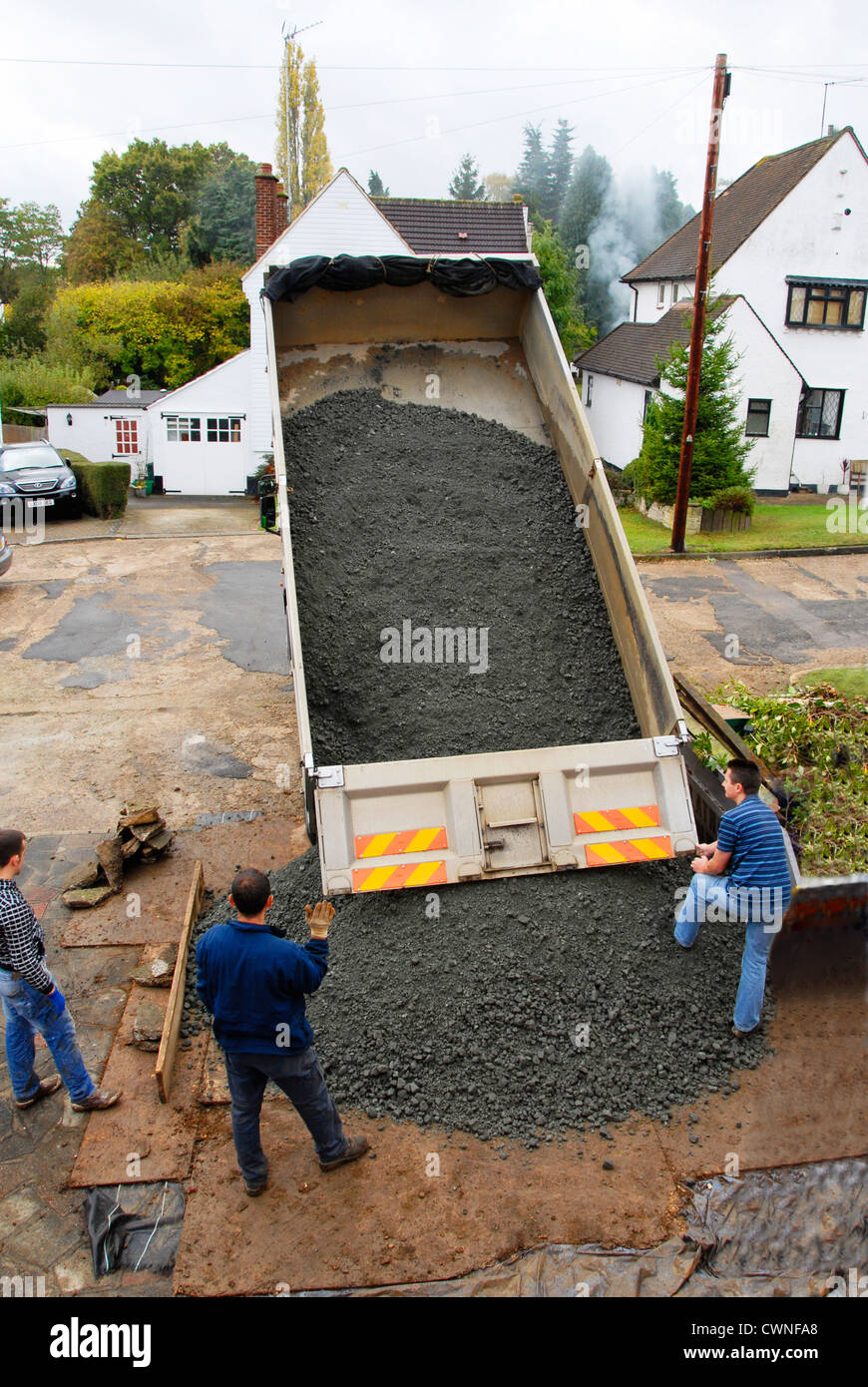 Tipper lorry unloading aggregate - Stock Image