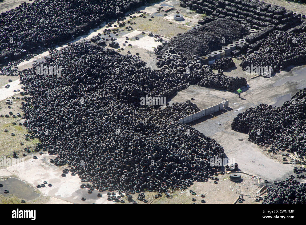 aerial view of a pile of car and other vehicle tyres tires - Stock Image