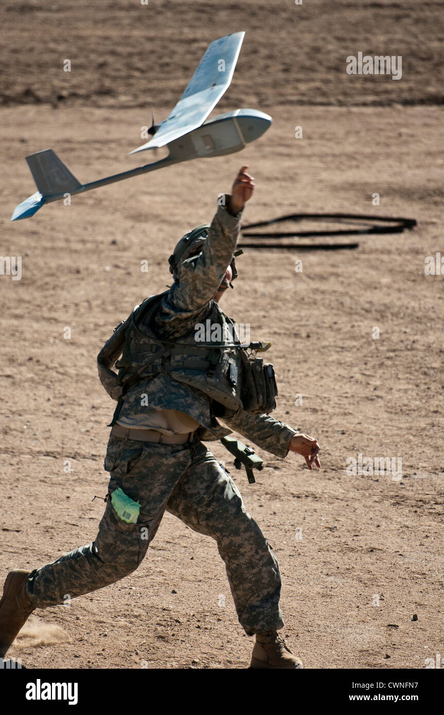A US Army soldier launches a Raven reconnaissance aircraft during an urban live-fire exercise October 13, 2011 at - Stock Image