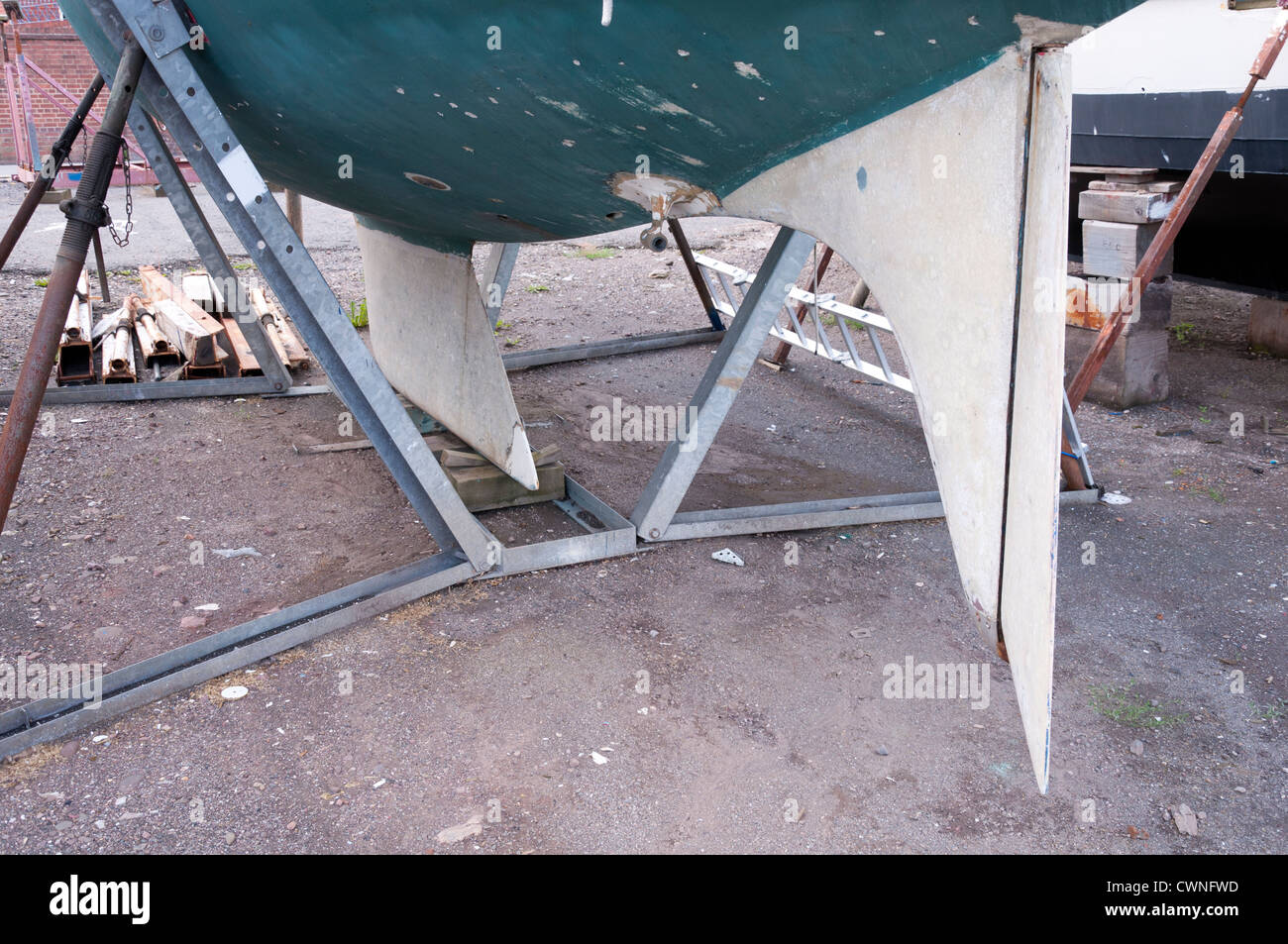 Rudder and Keel visible on a boat in dry dock. - Stock Image