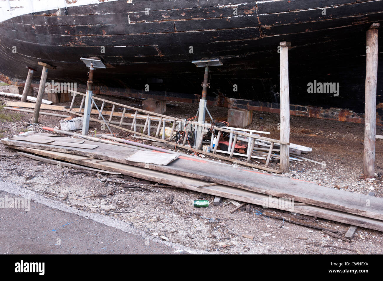 Wooden boat in dry dock undergoing restoration. - Stock Image