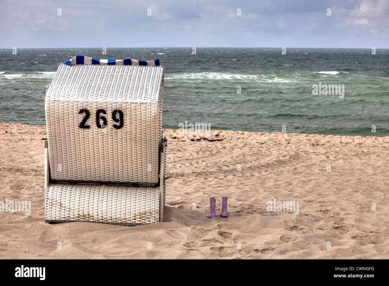 Beach chair, rubber boots, Sylt, Schleswig-Holstein, Germany - Stock Image