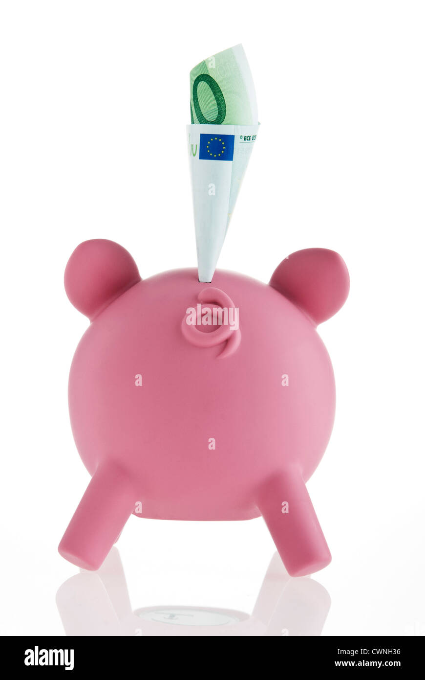 Pink piggy bank with a banknote - Stock Image