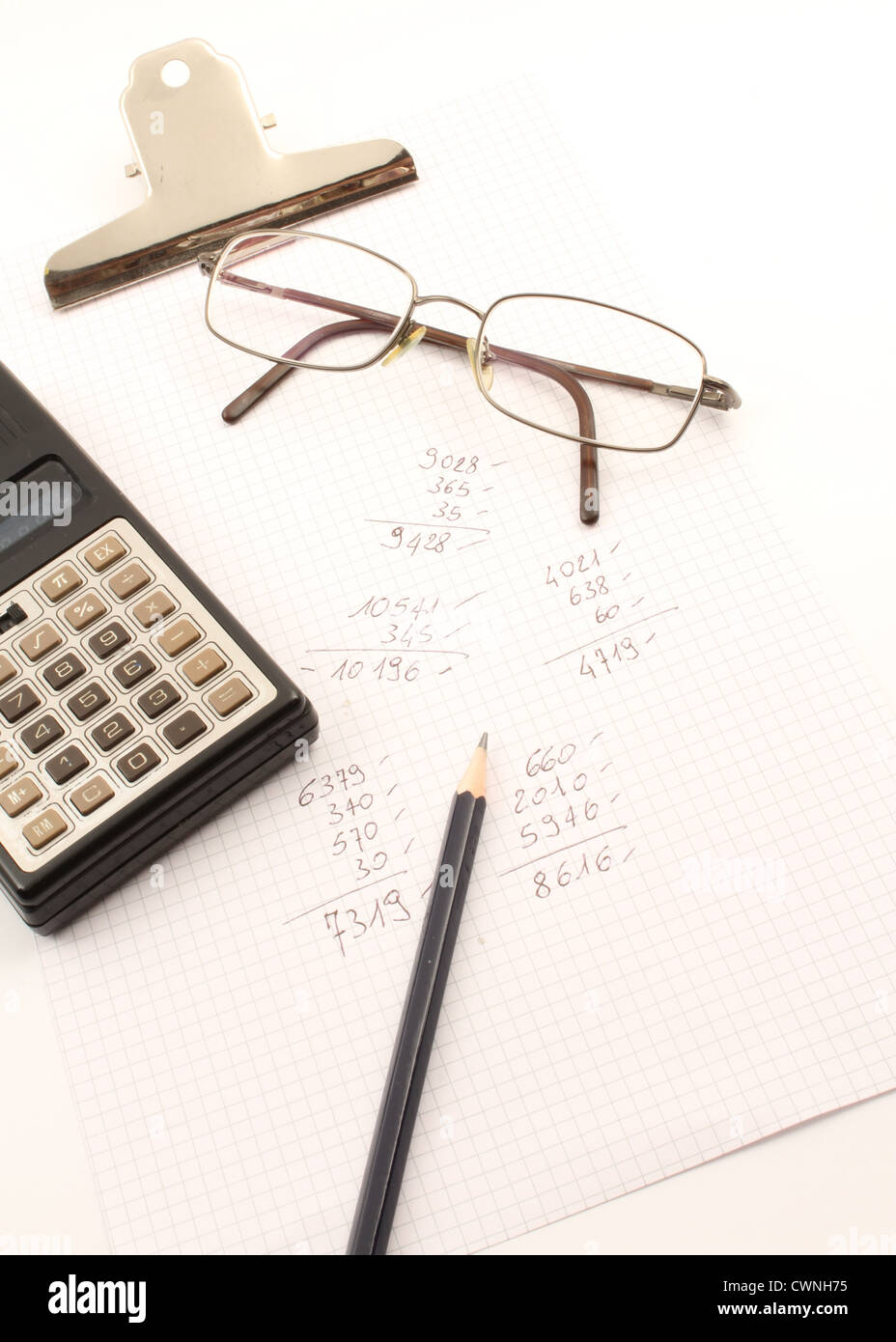 Written on a sheet of paper with a calculator and pen vintage. - Stock Image