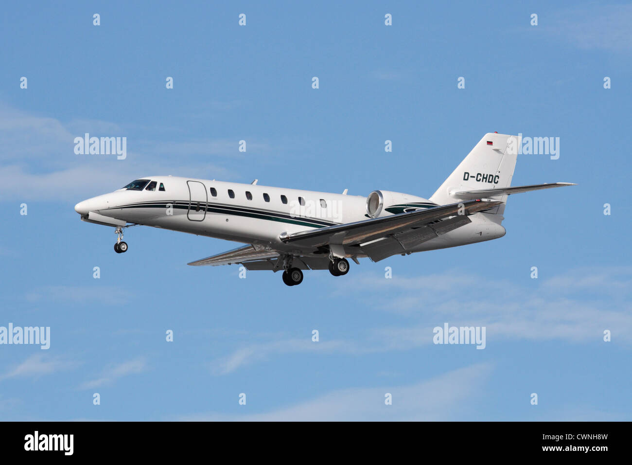 Corporate aviation. Cessna 680 Citation Sovereign business jet on approach - Stock Image