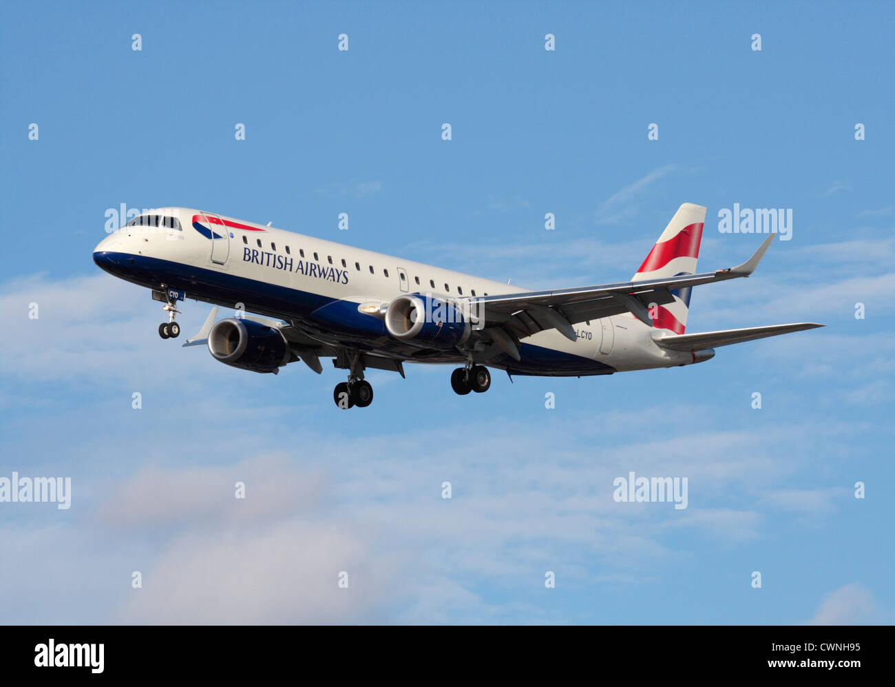 British Airways Embraer 190 regional jet on final approach - Stock Image
