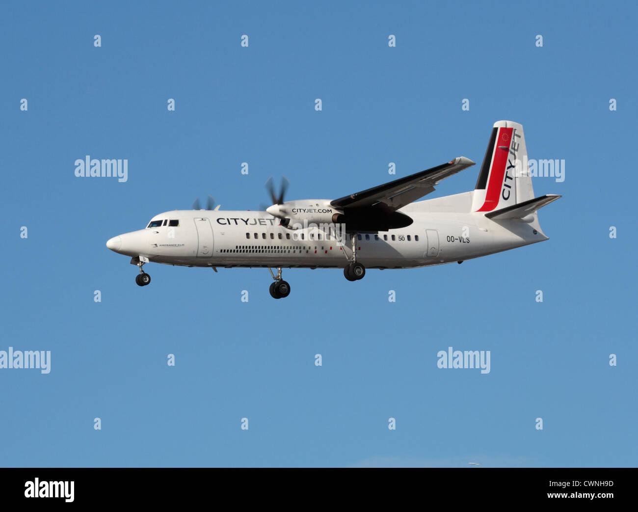 CityJet Fokker 50 on approach to London City Airport - Stock Image