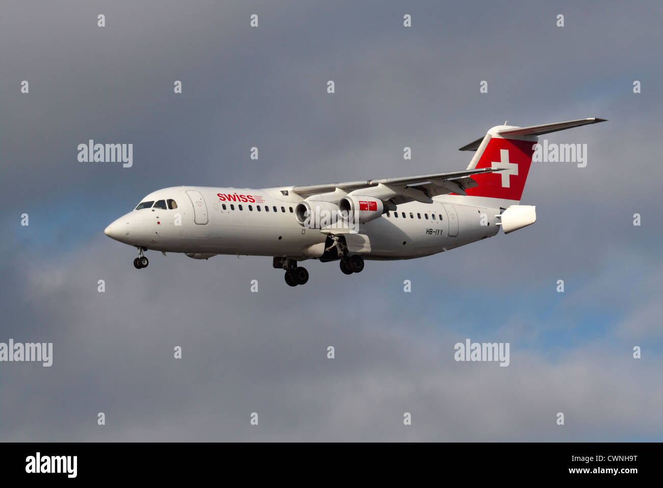 Swiss European Air Lines Avro RJ100 regional jet or small airliner flying on approach with tail airbrakes open. - Stock Image