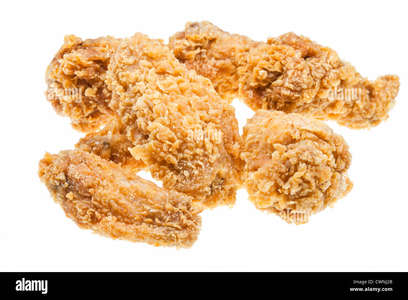 several hot fried chicken wings isolated white background - Stock Image