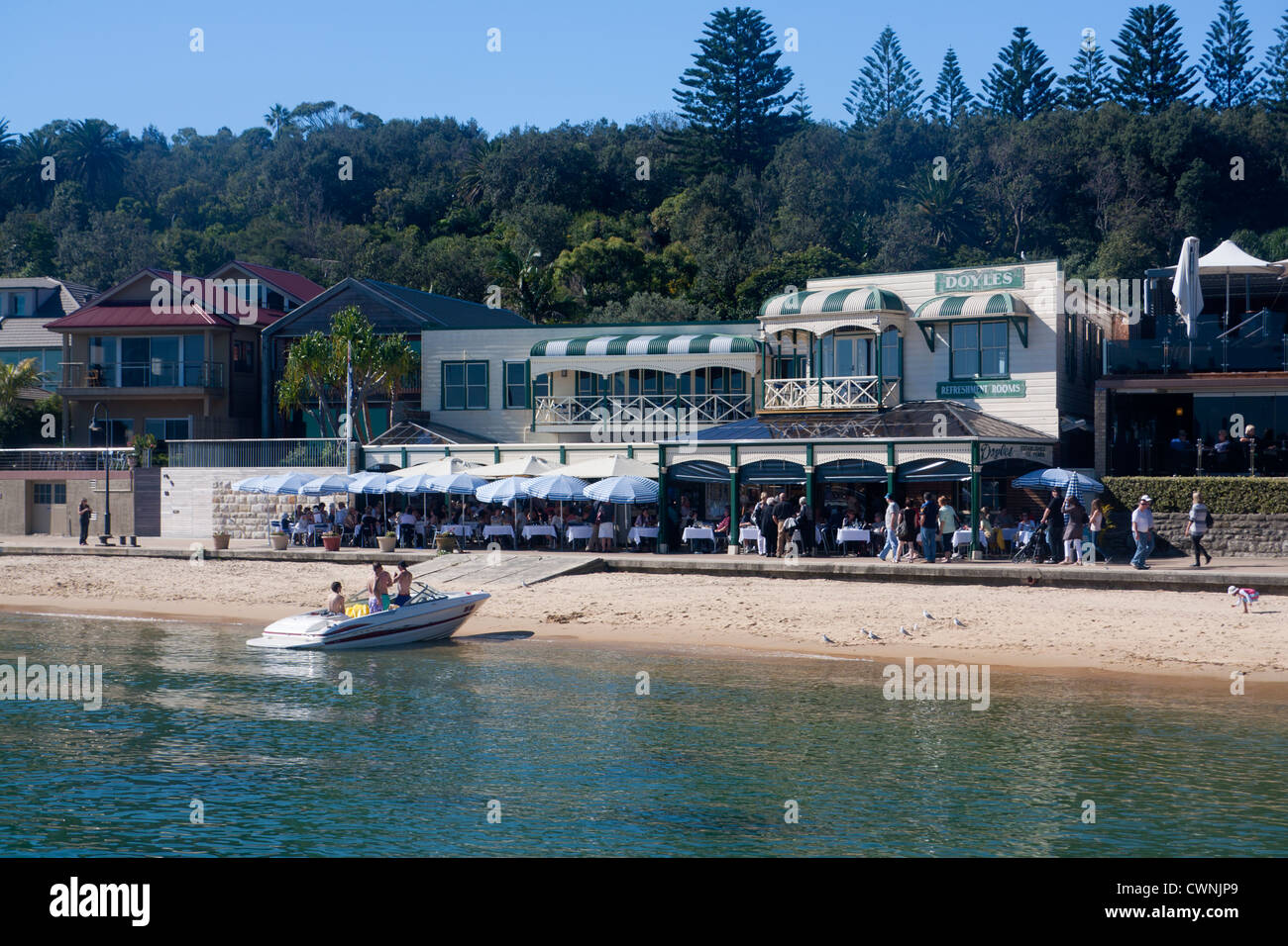 Doyles Restaurant and beach at Watsons Bay with boat in foreground Eastern Suburbs Sydney New South Wales Australia - Stock Image