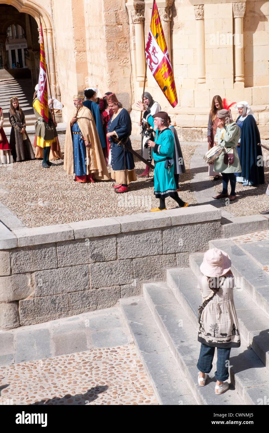 Woman taking photos at medieval performance. Segovia, Castilla Leon, Spain. - Stock Image